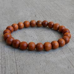 The basic style wood mala bracelet, perfect for layering with other bracelets. Cool California style in this casual wood bracelet, perfect for men and women. Braided Bracelets, Bracelets For Men, Fashion Bracelets, Fashion Jewelry, Beach Bracelets, Yoga Jewelry, Men's Jewelry, Jewellery, Chakra Jewelry