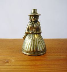 Antique Brass Bell Hand Etched Antique Brass Bell Lady in Hoop Skirt Colonial Pilgrim Puritan 1600s lady with hat from 1940s by TheIrishBarn on Etsy