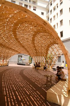 Gridshell Toledo - a construction experiment focusing on sustainability and innovation, using local wood with no glue or chemicals for the structure and skin laid in a geometric pattern to provide shade and comfort in the urban fabric