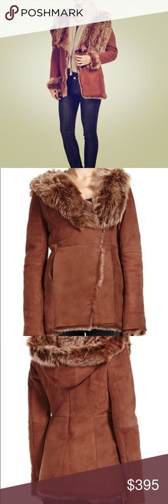 EMU Australia Swanhaven Sheepskin Jacket Size medium.  New, never worn, with tags.  Limited edition Very warm  Hooded double face jacket with 40mm snow top fleece finish Features large exagerated collar and hood with functional hook and eye closures Flattering fit with back panel details and concealed pockets 40mm fleece pile is soft and incredibly warm Woolmark quality accredited  A gift purchased for over $2000 at a charity fashion show but never worn. Emu Jackets & Coats Utility Jackets