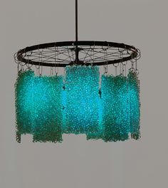 recycled glass pebbles w bicycle wheel :: cycLED pendant/chandelier by Fire & Water :: Furniture New York