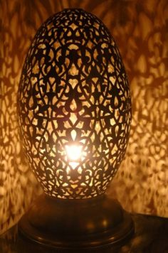 Moroccan Brass table light, Table lamp delicately chiselled of interlaced patterns of lys flowers. Moroccan Design