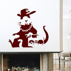 """You may be the hippest cat on your block, but this is the flyest rat on the street. Get this Banksy Wall Decals for your walls, stat, bro. """"Banksy is perhaps the most famous, or infamous, artist alive"""