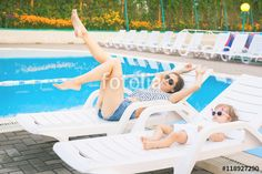 Endless summer! Cute baby and mother relaxing at sunbed