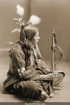 Indian holding Peace Pipe