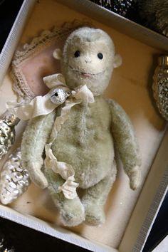 Hug Me Again Collectibles - Cheerful, tiny mohair monkey.