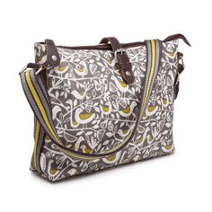 Doves print day bag complete with shoulder strap, zip top and extra magnetic clasp. In lovely tones of grey and green. Laminated cotton with leather trim. Measures 30 x 22 cm.  Matching items available.