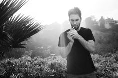 Adam Levine smoking a cigarette (or weed)