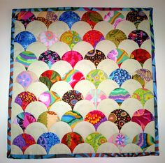 91 individually HANDSEWN English paper-pieced clamshells