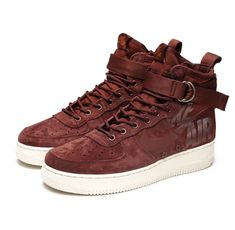 1c5985b63bf4c A reddish brown burgundy suede covers this Nike Special Field Air Force 1  Mid that is constructed out of suede and ballistic textile.
