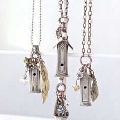 Made from recycled knife handles and souvenir pennies, these rustic birdhouse necklaces by Shelleen Weeks are darling do-overs that give new life to odds and ends, in the summer issue of Jewelry Affaire. #JewelryAffaire #repurpose #birdhouse #necklace