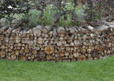 Gabion with firewood.