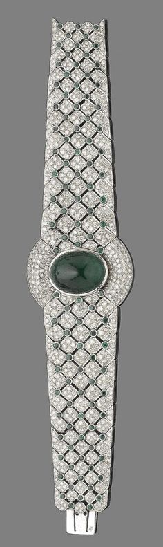 An emerald and diamond bracelet  Of tapering openwork design, set with brilliant-cut diamonds, interspersed by collet-set circular-cut emeralds, centrally-set with an oval cabochon emerald, diamonds approx. 9.50cts total, length 18.5cm