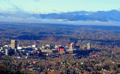 Beautiful downtown #Asheville NC Skyline on a winter morning with the Blue Ridge Mountains in the background