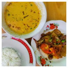 """Let's take a break from a fancy restaurant or cafe and enjoy a traditional Indonesian food in a little """"restaurant"""". I choose Oseng Daging, you'll have the soup (soto) and a plate of your meat (oseng daging) garnished in green chilis and tomatoes. The taste? I would give it 5 of 5!! Believe me, if you haven't tried this, you need to!   IDR 35,000 (Rice + Soto + Sweet Ice Tea)"""