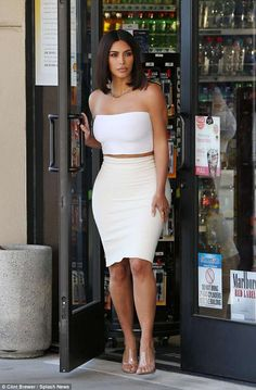 In great shape: Kim Kardashian showed off her body in a tube top and skirt in LA on Saturd...