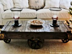 """Vintage industrial railroad cart for coffee table. She... """"cleaned it, sanded it, coated it with Minwax special walnut stain and polyurethaned the top and hardware."""""""