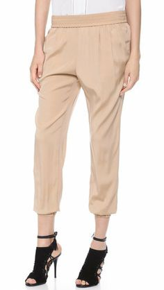 I like these but with a top not tucked in.  Emerson Thorpe Emilia Pants ($198)