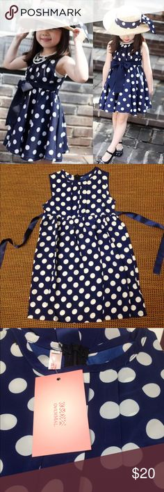 Adorable Blue & White Child's Polka Dot Dress Adorable Navy & White polka for dress. Zipper back with ribbon belt tie. Size 5/6, new never worn. 100% chiffon-polyester blend. Dresses Casual