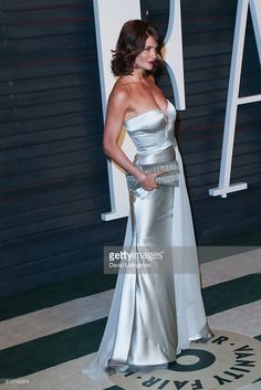 Model Helena Christensen arrives at the 2016 Vanity Fair Oscar Party Hosted by Graydon Carter at the Wallis Annenberg Center for the Performing Arts on February 28, 2016 in Beverly Hills, California.