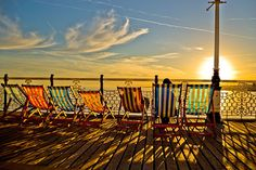 Who wouldn't want to lounge here? Deckchairs on #Brighton Pier, #UK.