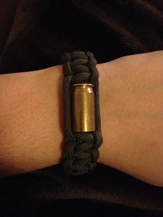 Items similar to Bullet Casing Paracord Survival Bracelet on Etsy Bullet Casing Crafts, Bullet Casing Jewelry, Bullet Crafts, Ammo Crafts, Hunting Crafts, Ammo Jewelry, Jewelry Crafts, Shotgun Shell Crafts, Shotgun Shells