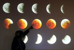 A Jakarta Planetarium and Observatory narrator, Cecep Nurwendaya shows the phase of a total lunar eclipse or the blood moon on the monitor during a press conference in Jakarta, Indonesia, on 08 October 2014. A total lunar eclipse or the blood moon not seen on 08 October 2014 because of jakarta's sky cloudy. According to the United States space agency, NASA, the 08 October 2014 blood moon is the second an extraordinary series of lunar eclipses. The first took place on the last 14 April 2014.