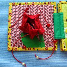 """Пошилась у меня небольшая """"цветная"""" книжечка. Как всегда, старалась использовать различные материалы - фетр, флис, хлопок, фланель, вельвет, ну и множество всяких пуговок, бусинок, ленточек) Особо расписывать не буду, просто, покажу фото. Идею с цветком я наглым образом стырила..."""