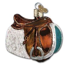 English Saddle Christmas Ornament. Hand-painted iridescent glass ornament accented with glitter. Great gift for any horse lover.