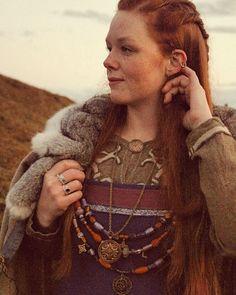 Visiting the burial mounds of Upsala always makes me feel empowered and calm. ✨ ~ #viking #vikingwoman #northwoman #redhead #freckles #gingerviking #ginger #empowered #empoweredviking #vikingclothing #aprondress #smokkr #vikingbling #vikingembroidery #kalevala #gamlauppsala