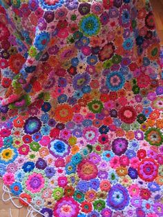 ❤ it . . . Crochet flowers by fperezajates- Multiple multi-sized crocheted  flowers made into one amazingly colorful  blanket