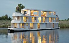 The Zambezi Queen Houseboat operates in the Chobe National Park. A luxury floating hotel with constant views of the wildlife enjoying the Chobe River. Chobe National Park, National Parks, Budapest, Best River Cruises, Luxury Houseboats, Best Cruise Lines, Floating Hotel, Floating Island, Les Continents
