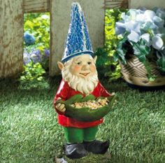 """Bird Feeder Gnome Solar Statue - Item weight: 1.4 lb  - Dimensions: 5 3/4"""" x 5"""" x 12 1/2"""" high  - Plastic polyresin and solar panel"""