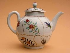 https://flic.kr/p/uChsAf | Teapot decorated with insects and flowers | Soaprock porcelain teapot decorated in Queen's pattern with gilt compartments containing flower sprigs and insects, attribbuted to Richard Chaffers and Co, Shaw's Brow, Liverpool circa 1760. HMCMS:DA2006.16 DPABOU82