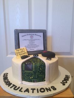 Computer Science Graduation Cake. Red velvet cake with cream cheese frosting.  Decorations are made of fondant and motherboard is edible paper.