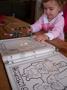 super easy busy book-- coloring and activity pages, plastic page protectors, binder, dry erase markers and crayons