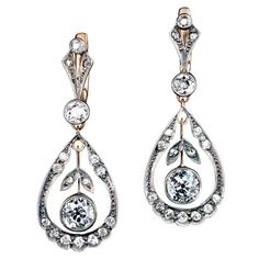 Antique Diamond Silver Gold Drop Earrings | From a unique collection of vintage dangle earrings at https://www.1stdibs.com/jewelry/earrings/dangle-earrings/