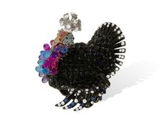 Lydia Courteille Turkey ring in blackened gold from the Animal Farm collection, set with black and white diamonds, topaz and amethyst.