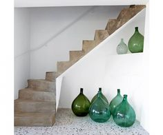 Demijohns clustered alongside a concrete stair in a vacation house on the border of Switzerland and Italy, discovered via Marie Claire Maison Casa Petra, Interior And Exterior, Interior Design, Ibiza Style Interior, Interior Stairs, Interior Decorating, Decorating Ideas, The Design Files, Home And Deco