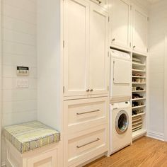 Built in laundry storage with built in bench