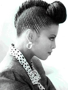 cornrowed french roll with pompadour - I still have a magazine cut-out of this hairstyle from the 80s.  Must get done!