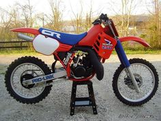 For old time's sake - 1985 Honda CR 250 - Hardwoods trail ride with a deep creek crossing. Honda Dirt Bike, Motorcycle Dirt Bike, Motocross Bikes, Vintage Motocross, Honda Motorcycles, Sport Bikes, Wooden Bicycle, Bicycle Decor, Bicycle Design
