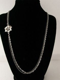 """This necklace is comprised of 3 mm link rolo chain, 2 mm gunmetal curb chain and a 35 mm metal sunflower.  It is 26 1/2"""" long.  Find more at:  http://www.zuluzjewels.com/"""
