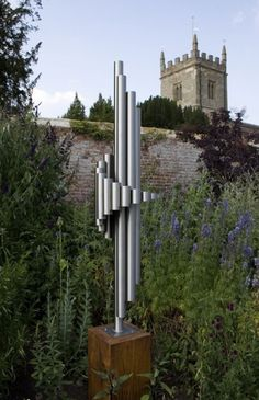 Stainless steel & oak Abstract Contemporary or Modern Outdoor Outside Exterior Garden / Yard Sculptures Statues statuary sculpture by artist Thomas Joynes titled: 'Alpha (medium)'