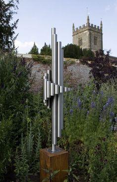 Stainless steel & oak Abstract Contemporary or Modern Outdoor Outside Exterior Garden / Yard Sculptures Statues statuary sculpture by artist Thomas Joynes titled: 'Alpha (medium)'