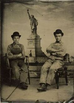 c. 1886-1910, [portrait of two gentlemen seated in front of painted backdrop depicting the Statue of Liberty] via Harvard University, Harvard Art Museums/Fogg Museum, Department of Photography