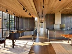 Residência em Berkshires, Massachussetts, USA. Designer principal: Tom Kundig. Arquiteto: Gus Lynch. Fotografia: Benjamin Benschneider.