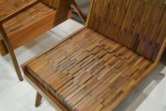 Super cool chair constructed of walnut blocks conforms to the shape of your tush and is super comfy. By Sitskie
