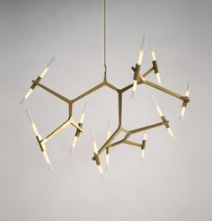 20 Bulb Agnes Chandelier  Designed by Lindsey Adelman for Roll & Hill, Agnes is a modular system of metal parts that support a swarm of tubular glass lights. Available in bronze, satin black, high gloss black, brass and polishded aluminum.