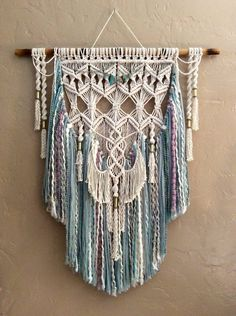 This is a fabulous layered Bohemian Large Macrame Wall Hanging with brass tubes and beautiful beading. There are two different ones pictured in a variety of textured yarns.Large colored macrame wall hanging woven wall hanging boho decor home decor bohemia Macrame Design, Macrame Art, Macrame Projects, Macrame Knots, Large Macrame Wall Hanging, Yarn Wall Hanging, Tapestry Wall Hanging, Wall Hangings, Modern Macrame